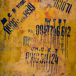 Hanoi's old quarter is the beating heart of the city and the eternal soul of Hanoian cultural architecture. Looking closer, one might find some hints about the presence and the past. This is the way people advertised their services back in the days (by painting their phone numbers an walls).