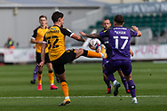 Newport County's Liam Shephard (32) under pressure from Tranmere Rover's Otis Khan (17) during the EFL Sky Bet League 2 match between Newport County and Tranmere Rovers at Rodney Parade, Newport, Wales on 17 October 2020.