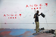 Charles Maclin cleans up after a session at the Anger Room in Dallas, Texas on November 18, 2016. (Cooper Neill for The New York Times)