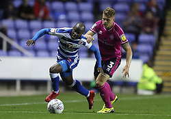 Reading's Sone Aluko (left) gets away from Queens Park Rangers's Jake Bidwell during the Sky Bet Championship match between Reading and Queens Park Rangers.