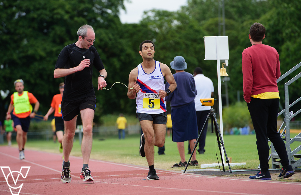 Event: 5000 meter relay<br /> Competitors, from left: Khalid Elkhereiji<br /> <br /> Metro Blind Sport's 42nd Athletics Open, held at Mile End Stadium, Tower Hamlets, London.<br /> <br /> Picture: Chris Vaughan Photography for Metro Blind Sports<br /> Date: June 16, 2018