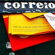panflets on old door postbox at Alfama