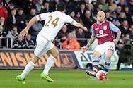 Aston Villa's Alan Hutton (r) plays the ball forward. Barclays Premier league match, Swansea city v Aston Villa at the Liberty Stadium in Swansea, South Wales on Saturday 19th March 2016.<br /> pic by  Carl Robertson, Andrew Orchard sports photography.