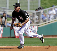 GLENDALE, AZ - MARCH 5:  Omar Vizquel #11 of the Chicago White Sox fields against the Los Angeles Dodgers on March 5, 2010 at The Ballpark at Camelback Ranch in Glendale, Arizona. (Photo by Ron Vesely/MLB Photos via Getty Images)  *** Local Caption *** Omar Vizquel