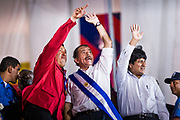 "10 JANUARY 2007 - MANAGUA, NICARAGUA: HUGO CHAVEZ, President of Venezuela, left, DANIEL ORTEGA, President of Nicaragua, and EVO MORALES, President of Bolivia, wave to the crowd during Ortega's inaugural speech in Managua.  Daniel Ortega, the leader of the Sandanista Front, was sworn in as the President of Nicaragua Wednesday. Ortega and the Sandanistas ruled Nicaragua from their victory of ""Tacho"" Somoza in 1979 until their defeat by Violetta Chamorro in the 1990 election.  Photo by Jack Kurtz"