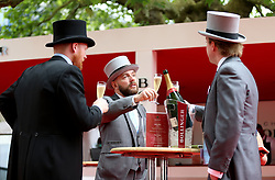 Racgoers enjoying a glass of champagne during day one of Royal Ascot at Ascot Racecourse.