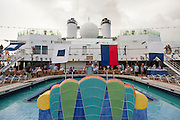 French Polynesia, the deck of a cruise ship tourists around the pool