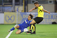 AFC Wimbledon striker Egli Kaja (21) performing a sliding tackle during the Pre-Season Friendly match between AFC Wimbledon and Burton Albion at the Cherry Red Records Stadium, Kingston, England on 21 July 2017. Photo by Matthew Redman.