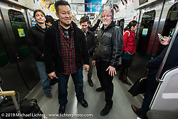 Another subway ride for (L>R) Charlie Wargow, Dais Nagao, Ben McGinley and Harley-Davidson head of design Ray Drea. Tokyo, Japan. Wednesday, December 10, 2014. Photograph ©2014 Michael Lichter.