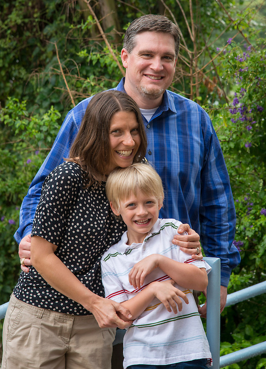 Harvard Elementary School teacher Jennifer Moore, left, poses for a photograph with her husband, Travis Elementary School principal Thomas Day. right, and their son Elliot, May 27, 2014.