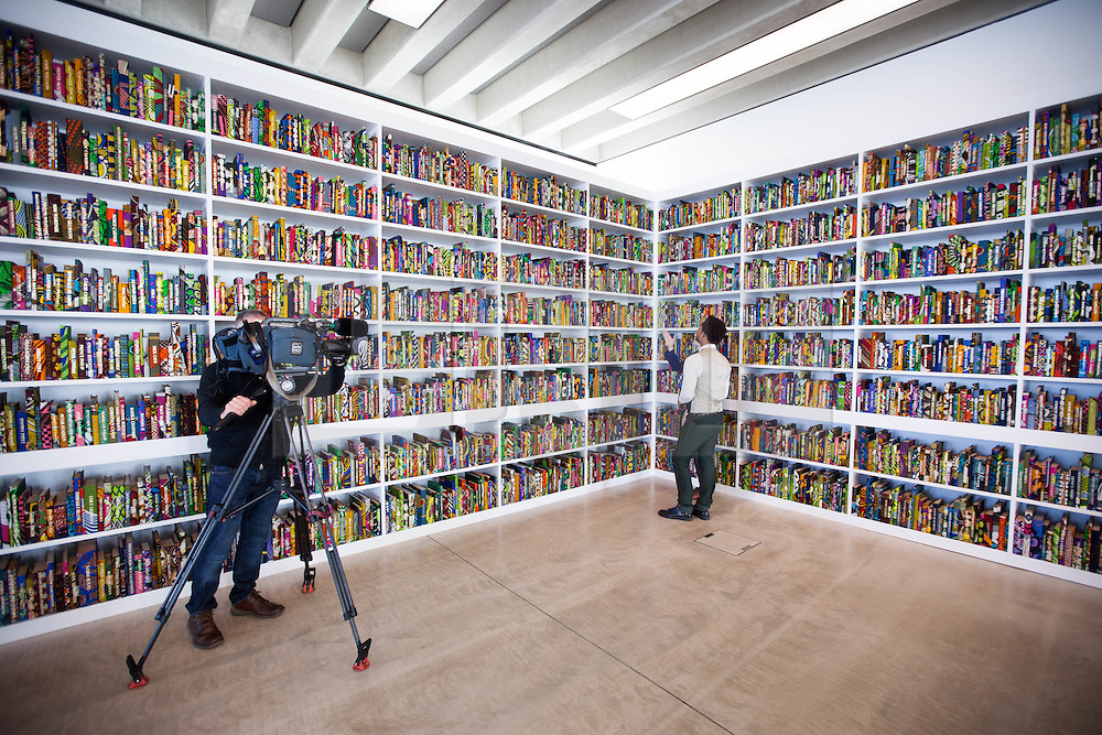 """@Licensed to London News Pictures 22/03/16.Margate, Kent. Yinka Shonibare MBE displays one of his sculptural work titled """"The British Library"""" at Turner Contemporary gallery in Margate, Kent. This piece of work is part of the 14-18 NOW programme of World War 1 Centenary Art commissions. Photo credit: Manu Palomeque/LNP"""