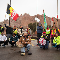 Johnnie Bobb, a Western Shoshone from Nevada leads the runners in prayer and song when they arrive at the Window Rock Tribal park following their Diné Missing and Murdered Sunrise Prayer Run Tuesday, Jan. 21 in Window Rock. The run began in Flagstaff Friday Jan. 17 ending in Window Rock the following Tuesday afternoon.