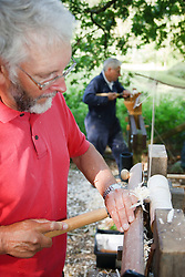 Volunteers at Bestwood Country Park, Nottinghamshire, part of Sherwood Forest, using pole lathe to turn green ie unseasoned wood: this craft was known as bodging.