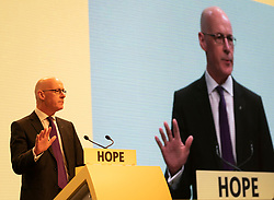 Edinburgh, Scotland, UK. 27 April, 2019. SNP ( Scottish National Party) Spring Conference takes place at the EICC ( Edinburgh International Conference Centre) in Edinburgh. Pictured; Deputy First Minister John Swinney addresses the delegates at the conference