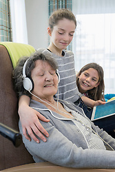 Senior woman spending time with grand children in rest home