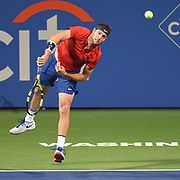 JACK SOCK hits a serve during his second round match at the Citi Open at the Rock Creek Park Tennis Center in Washington, D.C.