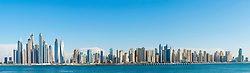 Skyline panorama on clear day of skyscrapers  in  Marina district of Dubai United Arab Emirates