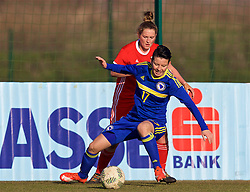 ZENICA, BOSNIA AND HERZEGOVINA - Tuesday, November 28, 2017: Wales' Rachel Rowe and Bosnia and Herzegovina's Amela Kršo during the FIFA Women's World Cup 2019 Qualifying Round Group 1 match between Bosnia and Herzegovina and Wales at the FF BH Football Training Centre. (Pic by David Rawcliffe/Propaganda)