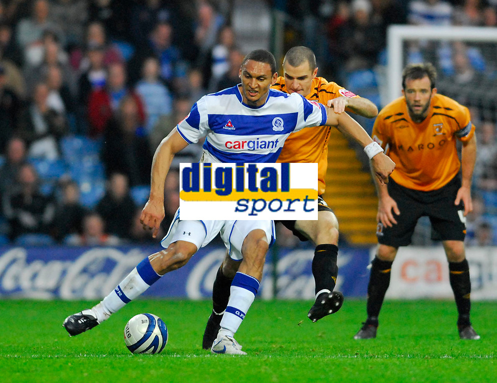 Photo: Leigh Quinnell/Sportsbeat Images.<br /> Queens Park Rangers v Hull City. Coca Cola Championship. 03/11/2007. QPRs Marc Nygaard comes under attack from Hulls Dean Marney.