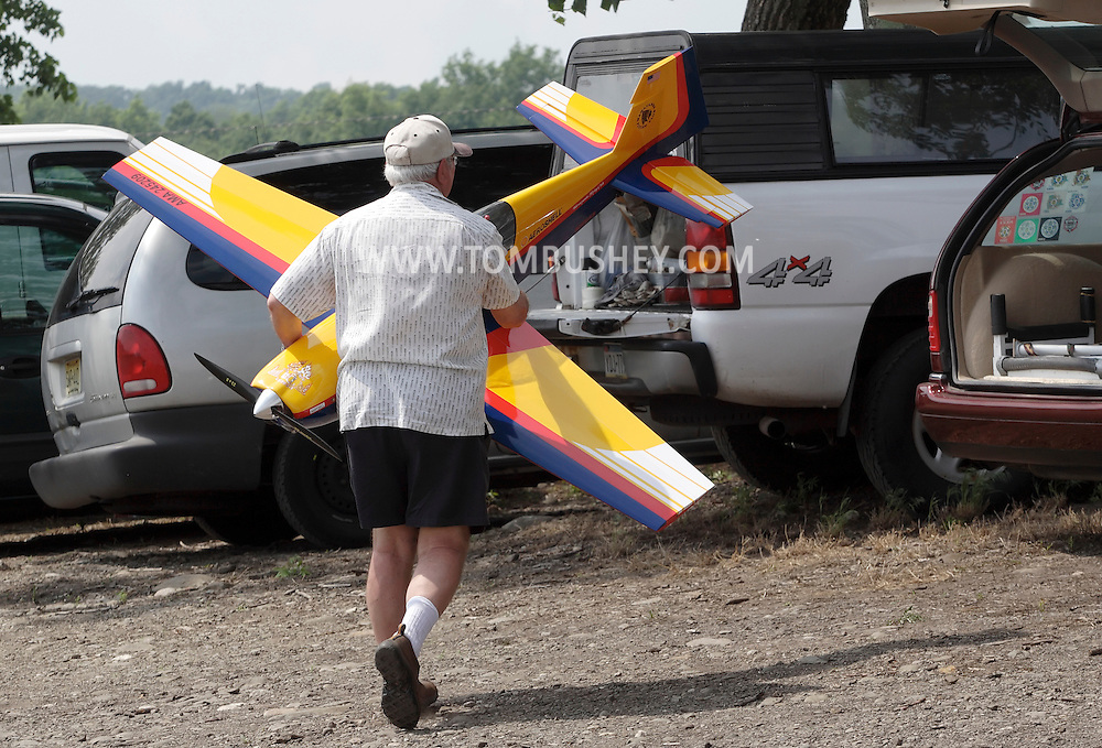 New Hampton, New York - A man carries his remote controlled airplane to his car during a fly-in sponsored by the Wawayanda Flying Club on June 5, 2010.