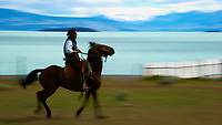 Gaucho riding a horse at Estancia Helsingfors in Patagonia. Image taken with a Nikon D3s camera and 24-120 mm f/4  lens (ISO 200, 120 mm, f/22, 1/25 sec)