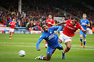 Peterborough United forward Ivan Toney (17) wanted a penalty for this challenge by Barnsley defender Ethan Pinnock (5) during the EFL Sky Bet League 1 match between Peterborough United and Barnsley at The Abax Stadium, Peterborough, England on 6 October 2018.