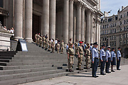Members of the RAF Royal Air Force and British Army stand to attention while rehearsing the ceremonial event to mark the Queens 90th birthday the oldest for any British monarch at St Pauls Cathedral, on 9th June 2016, in London, United Kingdom. In summer sunshine they practice marching into position and ensuring theyre precisely in the correct spacing in preparation for the monarchs celebration here on 10th June, the day after.