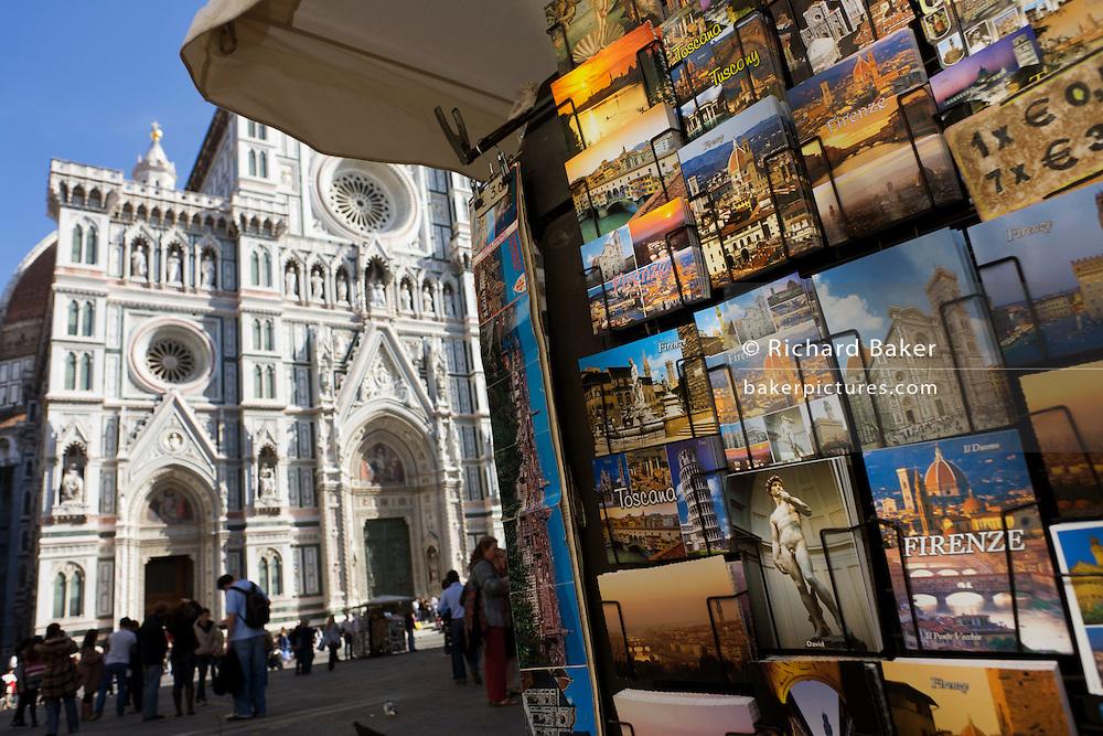 Postcards rack in Piazza Santa Giovanni beneath Florence's Santa Maria del Fiore (Duomo) Cathedral.
