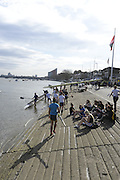 London, United Kingdom.  Athletes enjoy the sunshine while they wait to boat for the afternoon head race. 2014 Women's Head of the River Race. Chiswick to Putney, River Thames.  Saturday  15/03/2014    [Mandatory Credit; Peter Spurrier/Intersport-images]