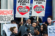 "Supporters of Mark Duggan's family hold a vigil outside Tottenham  police station. They gathered, alongside family members and his mother Pam Duggan, at 2pm following an inquest jury ruling that Duggan was lawfully killed when police shot him dead while he was unarmed.  Within days of his shooting, in 2011, rioting broke out on the streets of London, and spread to other urban areas in England.  Pastor Nims Obunge (pctured with mike) who oversaw Duggan's funeral in 2011, said: ""The message from the family is that this vigil is intended to be a very peaceful vigil"". Tottenham, London, UK 11 January 2014. Guy Bell, 07771 786236, guy@gbphotos.com"