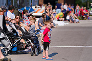 03 JULY 2021 - NORWALK, IOWA: A child waits for the 4th of July parade to start in Norwalk, Iowa. Last year's parade was cancelled because of the COVID-19 pandemic. Norwalk is an agricultural community south of Des Moines. In recent years, Norwalk has become a suburb of Des Moines.        PHOTO BY JACK KURTZ