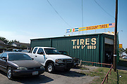 Latino Discount Tires photographed on October 20, 2014 in Irving, Texas. (Cooper Neill for The Texas Tribune)