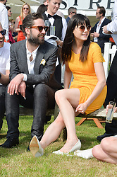 JACK GUINNESS and LILAH PARSONS at the St.Regis International Polo Cup at Cowdray Park, Midhurst, West Sussex on 17th May 2014.