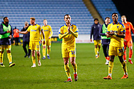 Wimbledon midfielder Dylan Connolly (16) applauds the fans during the EFL Sky Bet League 1 match between Coventry City and AFC Wimbledon at the Ricoh Arena, Coventry, England on 12 January 2019.