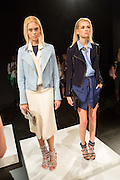 Jackets in powder blue and navy, with diagonal front zippers which open to wide lapels. By Monika Chiang at Spring 2013 Fashion Week in New York.