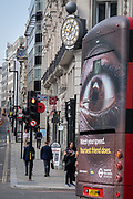 Looking westwards from Ludgate Hill towards Fleet Street at the busy traffic junction of the Farringdon Road in the City of London, and a London bus carrying an ad about speeding in the capital, on 16th September 2020, in London, England.