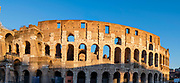 Image of the Coliseum in Rome as the sun is setting on a December afternoon.