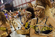 Women dressed as cave people, Salgueiro Samba School from the Special Group, practices their Carnival procession in the Sambadrome, Rio de Janeiro, Brazil