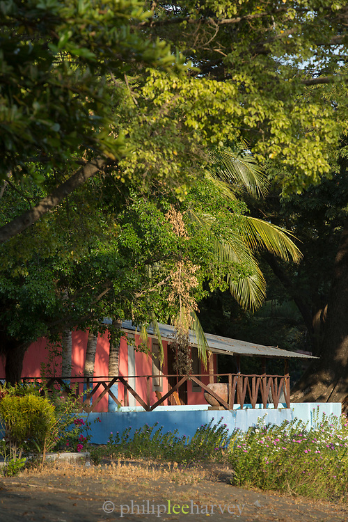 View of a small house hidden under trees, Ometepe Island, Nicaragua
