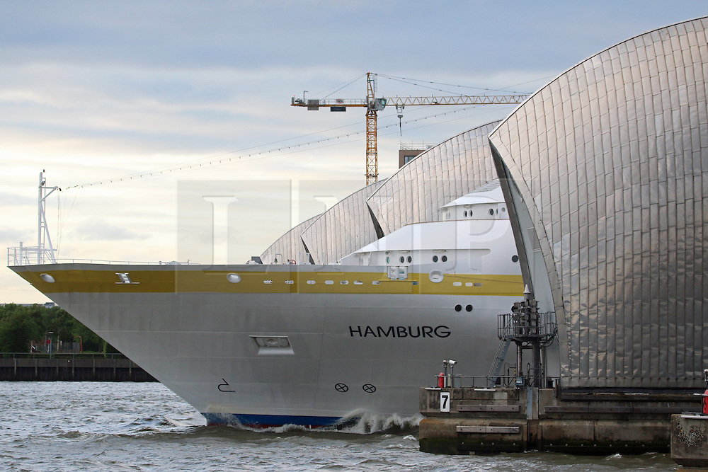 ***LNP BEST OF WEEK SELECTION*** © Licensed to London News Pictures. 08/05/2014. London's 2014 cruise ship season has got under way with the arrival of MV HAMBURG last night (7th April). The 144-metre long vessel, operated by Plantours Kreuzfahrten, is the first cruise visitor to the capital of the year. She passed landmarks such as the Dartford Bridge, Thames Barrier and Tower Bridge as she made her way up to a mooring in the Upper Pool of London under a cloudy sky. Credit : Rob Powell/LNP