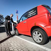 Nederland, amsterdam , 8 maart 2011..De Nederlandse Turkse ondernemer in electrische auto's dhr. Kilicarslan haalt de electrische voeding van zijn auto af..Actief Lease company buys 40 electric cars for small entrepreneurs inAmsterdam.
