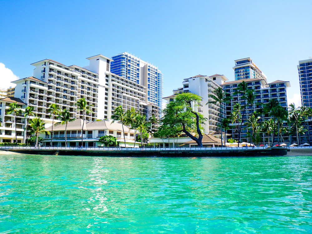 The Halekulani Hotel, the Hawaiian name meaning House Befitting Heaven, located on Waikiki beach in Honolulu, Hawaii offers stunning views of Diamond Head in a historic, secluded and exclusive setting.  The view of the Halekulani from the water.