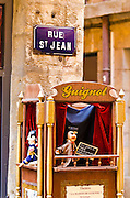 Street sign and puppet Guignol in old town Vieux Lyon, France  (UNESCO World Heritage Site)
