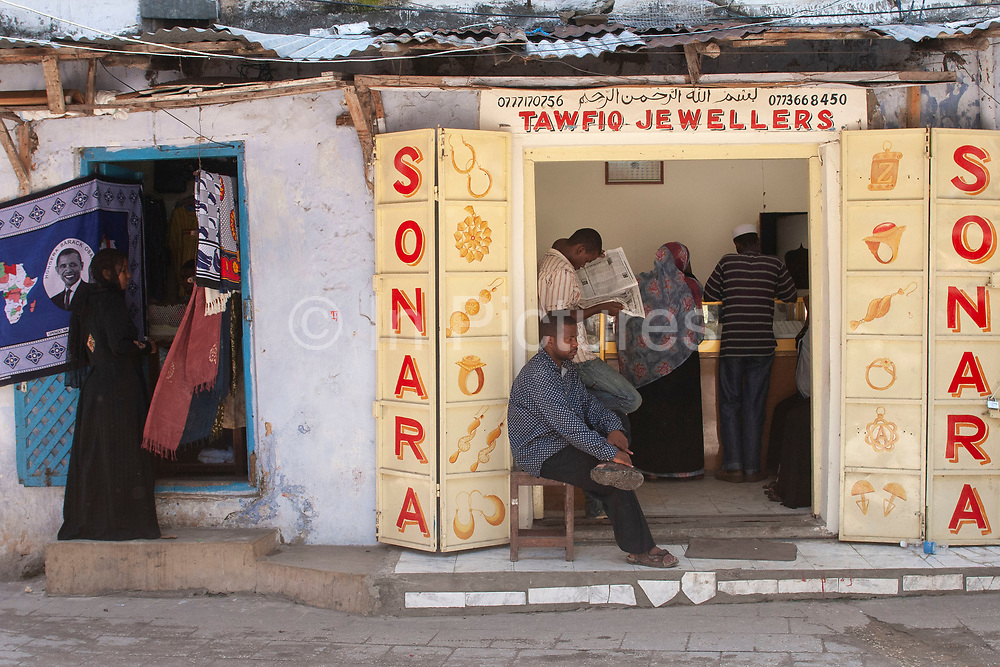 Jewellers shop in Stone Town on 6th December 2008 in Zanzibar, Tanzania. Originally the size of the door would speak of the owners status or wealth. Zanzibar is a small island just off the coast of the Tanzanian mainland in the Indian Ocean. In part due to its name, Zanzibar is a travel destination of mystical reputation, known for its incredible sealife on its many reefs, the powder white coral sand beaches and the traditional cultivation of spices.