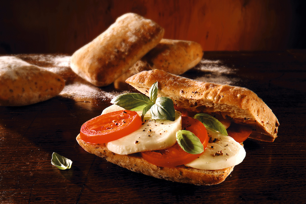mozerella,  and  tomato chiabatta sandwich. Food photos.