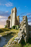 Medieval Corfe castle keep  close up  sunrise, built in 1086 by William the Conqueror, Dorset England . Built by William the Conqueror, the castle dates to the 11th century and commands a gap in the Purbeck Hills on the route between Wareham and Swanage. The first phase was one of the earliest castles in England to be built at least partly using stone when the majority were built with earth and timber. Corfe Castle underwent major structural changes in the 12th and 13th centuries. In 1643 Parliamentary Forces sieged the Royal Corfe Castle but was unsuccessful. By 1645 Corfe was one of the last remaining royalist strongholds in southern England and fell to a siege ending in an assault. In March that year Corfe Castle was slighted (ruined) on Parliament's orders. <br /> <br /> Visit our MEDIEVAL PHOTO COLLECTIONS for more   photos  to download or buy as prints https://funkystock.photoshelter.com/gallery-collection/Medieval-Middle-Ages-Historic-Places-Arcaeological-Sites-Pictures-Images-of/C0000B5ZA54_WD0s