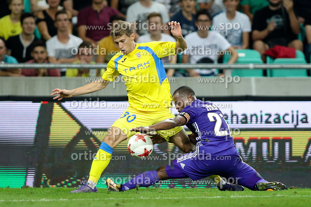 Petar Franjic of NK Domzale and Patrice Evra of Olympic Marseille during football match between NK Domzale and Olympique de Marseille in First game of UEFA Europa League playoff round, on August 17, 2017 in SRC Stozice, Ljubljana, Slovenia. Photo by Morgan Kristan / Sportida
