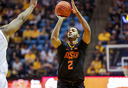 Jan 12, 2019; Morgantown, WV, USA; Oklahoma State Cowboys forward Maurice Calloo (2) shoots a three pointer during the first half against the West Virginia Mountaineers at WVU Coliseum. Mandatory Credit: Ben Queen-USA TODAY Sports