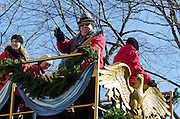NEW YORK, NY, USA, Nov. 28, 2013. Mannheim Steamroller rides a train-themed float in the 87th Annual Macy's Thanksgiving Day Parade.