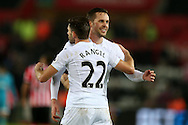 Gylfi Sigurdsson of Swansea city ® and teammate Angel Rangel celebrate at the end of the match.Premier league match, Swansea city v Southampton at the Liberty Stadium in Swansea, South Wales on Tuesday 31st January 2017.<br /> pic by  Andrew Orchard, Andrew Orchard sports photography.